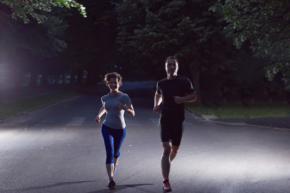urban sports, healthy couple jogging in the city at early morning in night
